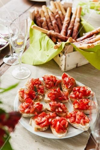 Bruschetta and grissini with Parma ham