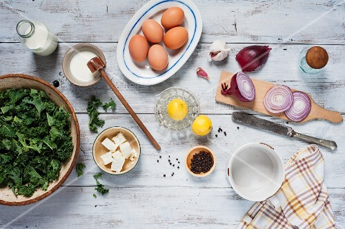 Ingredients for a quiche with kale and feta cheese