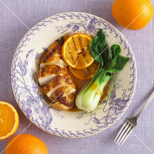 Chicken breast with orange sauce and pak choi
