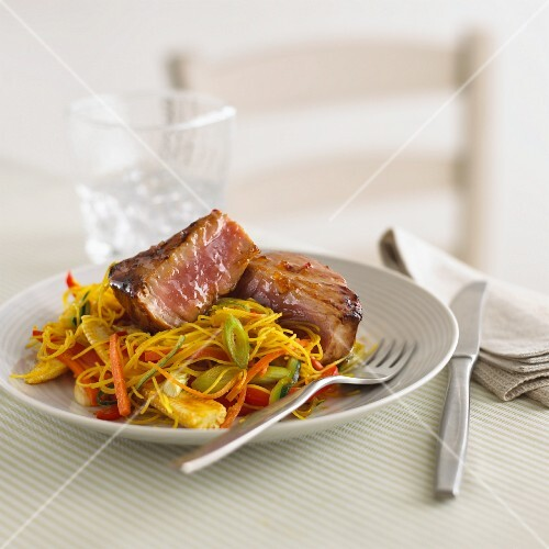 Tuna on a bed of noodles with vegetables