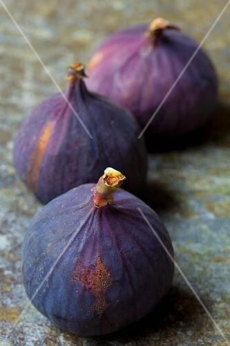 Three fresh red figs