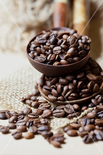 Roasted coffee beans in ladles