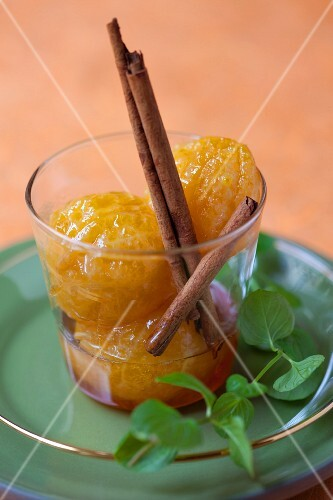 Caramelised clementines with cinnamon sticks