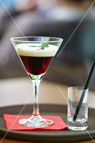 Coffee liqueur with cream and coffee beans