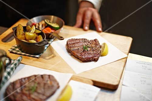 Beef steak with potatoes and vegetables in a restaurant