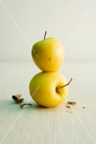 Golden Delicious apples, stacked one on top of the other