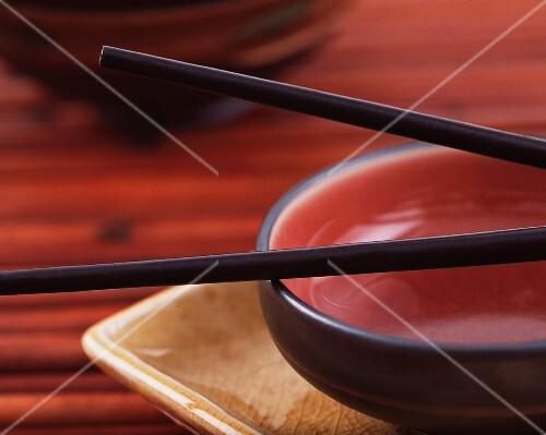 An oriental bowl with chopsticks (close-up)