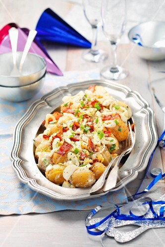 Potatoes boiled in their skins, with shallots, bacon, eggs and mayonnaise
