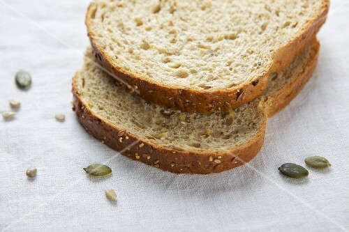 Sliced brown bread with sunflower seeds and pumpkin seeds