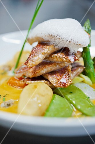 Red mullet with spring vegetables and foam