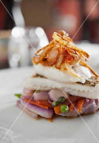 Cod with spring vegetables and fried onions