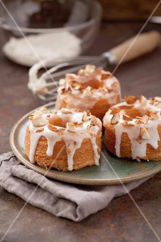 Amaretto doughnuts with sugar glaze and almond pieces