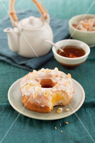 Doughnut with candied ginger pieces and sugar glaze
