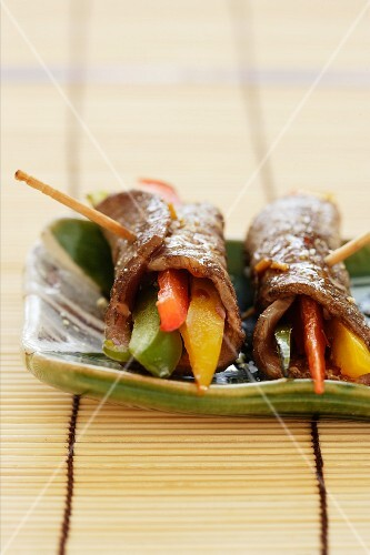 Rolled slices of beef filled with colourful strips of pepper