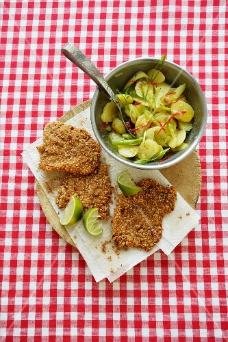 Schnitzel with sesame seed coating and potato salad with chilli