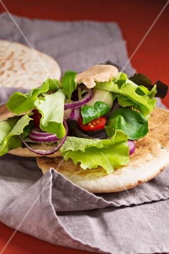 Salad and balls of mozzarella in a pita bread
