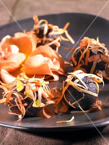 Chocolate balls with rose petals