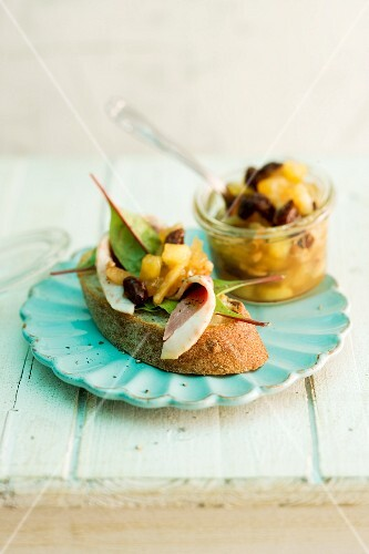 Baked apple chutney served with bread and ham