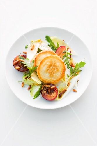Blinis on endive salad
