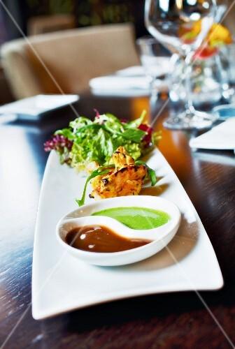 tandoori prawn with salad and two sauces