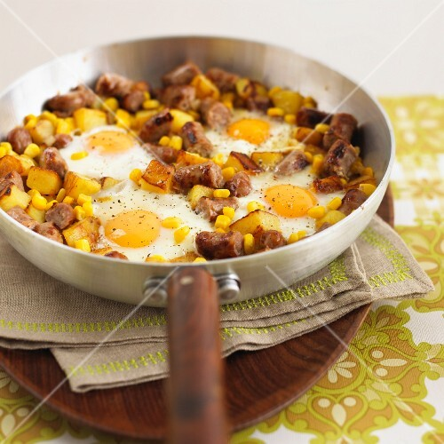 Hash browns with pieces of sausage, sweetcorn and fried eggs