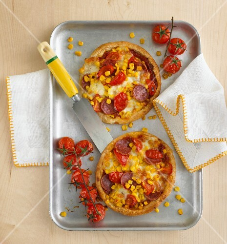 Mini tarts with salami, sweetcorn and tomatoes (view from above)