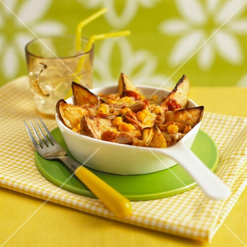 Potato wedges with sweetcorn, topped with cheese and grilled