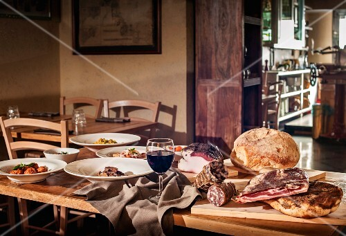 A table laid for a rustic meal in an Italian restaurant
