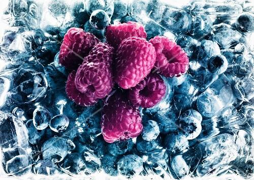 Raspberries on frozen blueberries