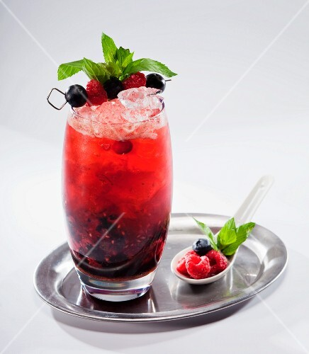 Fruit cocktail with berry juice on a silver tray