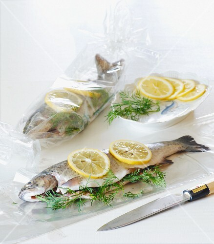 Trout cooked in a roasting bag with dill and lemon