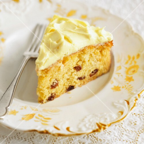 A slice of lemon cake with raisins