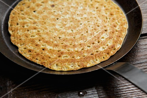 A pancake in a frying pan
