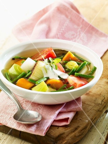 Vegetable soup with leek, carrots and tomatoes