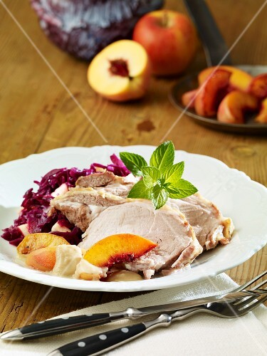 Collar of pork with peach sauce and red cabbage