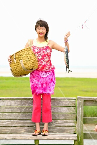 Portrait of woman catching fish