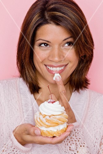 Portrait of woman tasting pastry