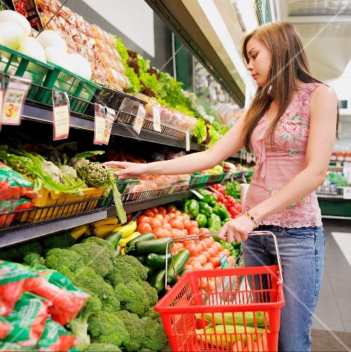 Woman selecting produce at supermarket