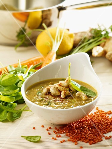 Carrot and lentil soup with spinach and cashew nuts