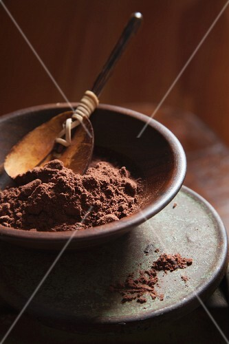 Coco Powder in a Brown Bowl with Wood Spoon