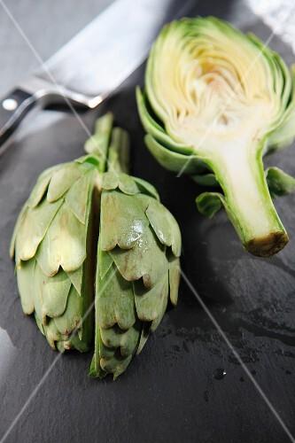 Still life of chopped artichokes on a slate cutting board