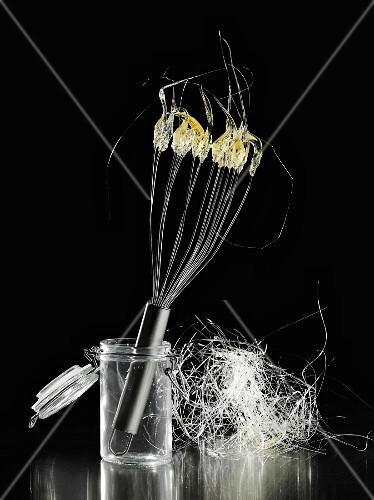 Spun sugar on an egg whisk