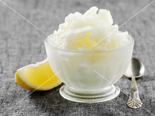 Lemon granita and a wedge of lemon