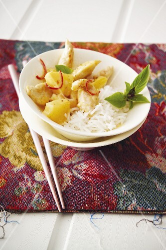 Pieces of chicken with pineapple and rice