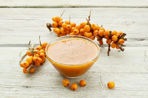 Sea buckthorn jam and fresh sea buckthorn berries