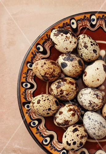 Quail's eggs on a patterned plate