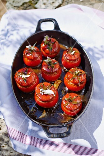 Stuffed tomatoes in a roasting pan