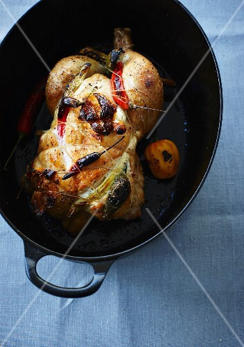 Whole chilli chicken in a roasting dish