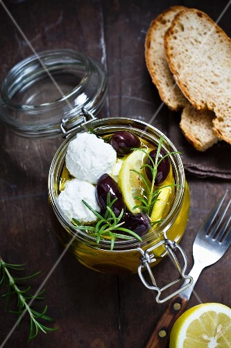 Marinated goat's cheese with lemons and olives