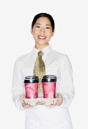 Asian female server holding to-go coffees